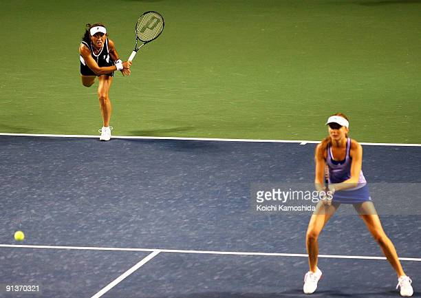 Ai Sugiyama of Japan and Daniela Hantuchova of Slovakia serve in the doubles final match against Francesca Schiavone of Italy and Alisa Kleybanova of...