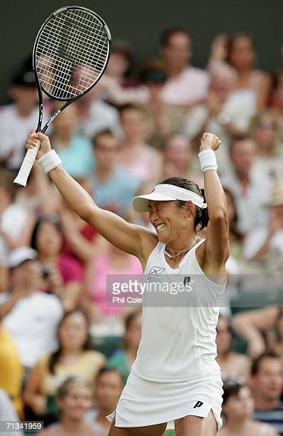 Ai Sugiyama of Japan celebrates her victory over Martina Hingis of Switzerland during day five of the Wimbledon Lawn Tennis Championships at the All...
