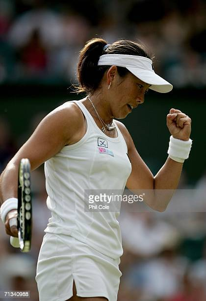 Ai Sugiyama of Japan celebrates winning a point against Martina Hingis of Switzerland during day five of the Wimbledon Lawn Tennis Championships at...