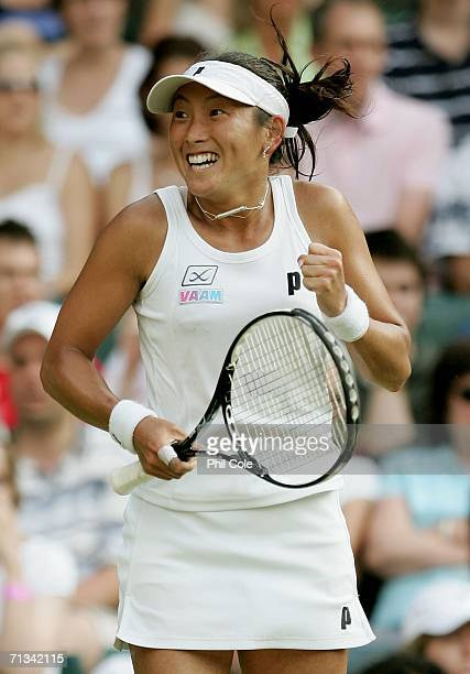 Ai Sugiyama of Japan celebrates winning match point against Martina Hingis of Switzerland during day five of the Wimbledon Lawn Tennis Championships...