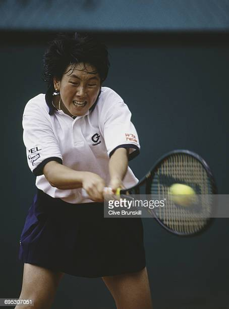 Ai Sugiyama of Japan eyes the ball as she returns against Jolene Watanabe during their Women's Singles third round match at the French Open Tennis...