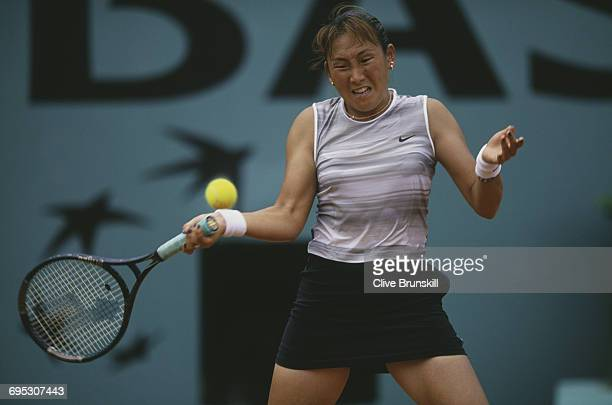 Ai Sugiyama of Japan eyes the ball as she returns against Sylvia Plischke during their Women's Singles third round match at the French Open Tennis...