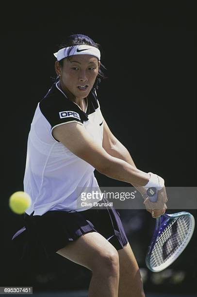 Ai Sugiyama of Japan eyes the ball for a back hand return against Iva Majoli during their Women's Singles third round match at the ATP Lipton Tennis...