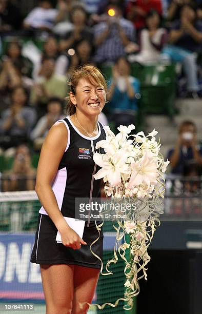 Ai Sugiyama of Japan poses for photographs at her retiring ceremony during the day seven of the Toray Pan Pacific Open Tennis at Ariake Colosseum on...