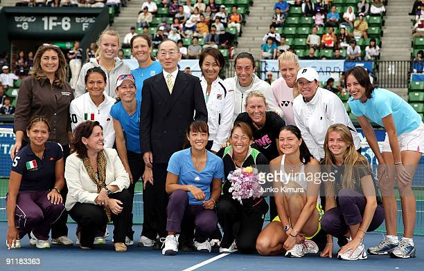 Ai Sugiyama of Japan poses with fellow players during a special ceremony on day one of the Toray Pan Pacific Open Tennis tournament at Ariake...
