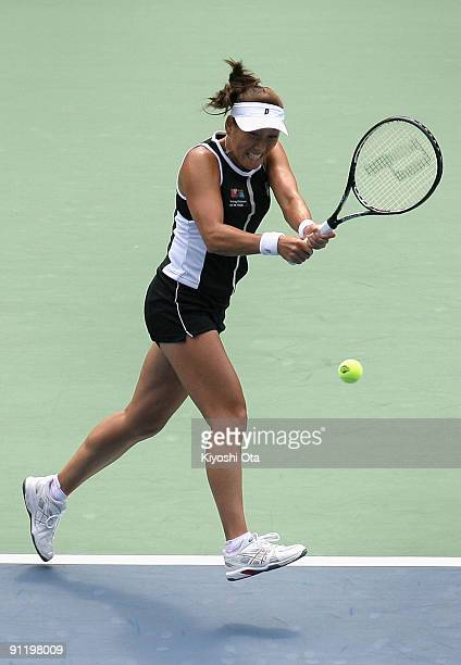 Ai Sugiyama of Japan returns a shot in in her first round match against Nadia Petrova of Russia on day two of the Toray Pan Pacific Open Tennis...