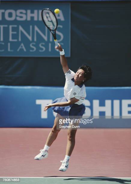 Ai Sugiyama of Japan serves during a WTA Women's Doubles match at the Toshiba Classic Tennis Tournament on 5 August 1994 at the La Costa in San Diego...