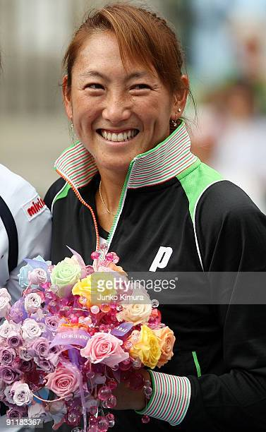 Ai Sugiyama of Japan smiles during a special ceremony on day one of the Toray Pan Pacific Open Tennis tournament at Ariake Colosseum on September 27...