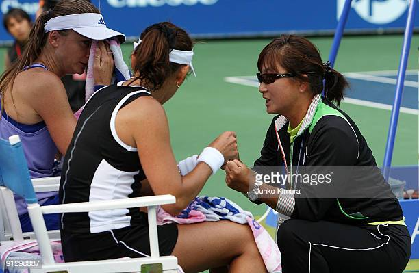 Ai Sugiyama of Japan talks to her coach and mother Fusako Sugiyama during her doubles match with her partner Daniela Hantuchova of Slovakia against...