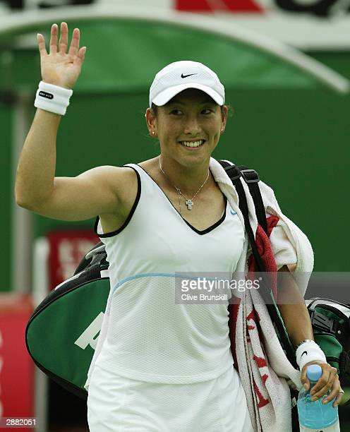 Ai Sugiyama of Japan thanks the crowd after winning her match against Tatiana Panova of Russia during day two of the Australian Open Grand Slam at...