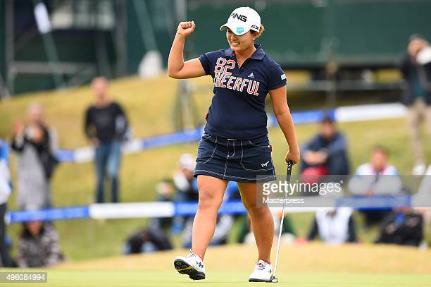 Ai Suzuki of Japan celebrates after making her birdie putt on the 18th green during the second round of the TOTO Japan Classics 2015 at the Kintetsu...
