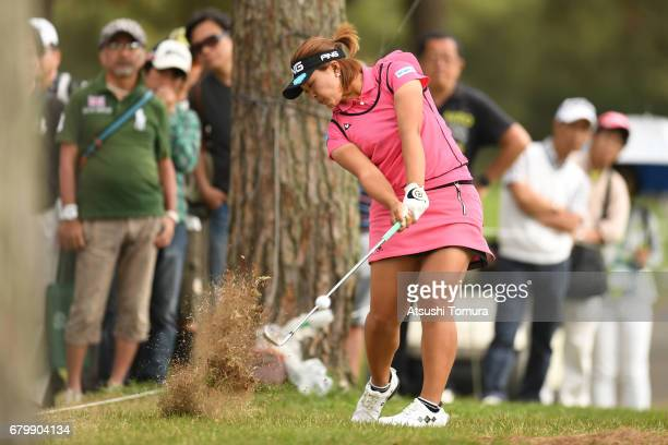 Ai Suzuki of Japan hits her second shot on the 12th hole during the final round of the World Ladies Championship Salonpas Cup at the Ibaraki Golf...