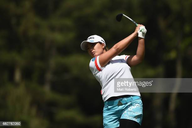 Ai Suzuki of Japan hits her second shot on the 4th hole during the final round of the HokennoMadoguchi Ladies at the Fukuoka Country Club Wajiro...
