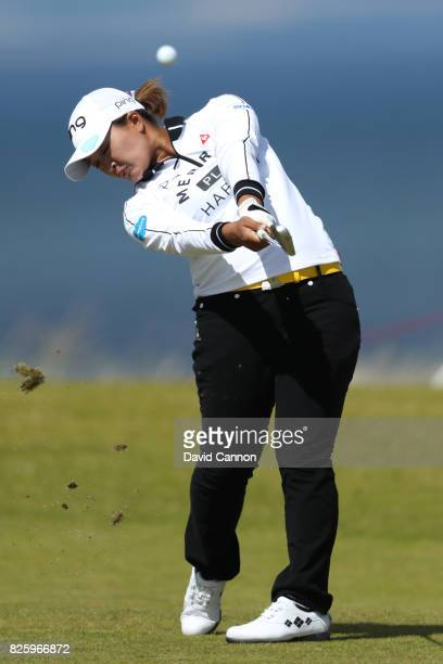 Ai Suzuki of Japan hits her second shot on the 4th hole during the first round of the Ricoh Women's British Open at Kingsbarns Golf Links on August 3...