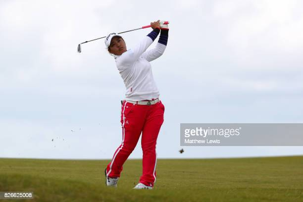Ai Suzuki of Japan hits her second shot on the 4th hole during the third round of the Ricoh Women's British Open at Kingsbarns Golf Links on August 5...