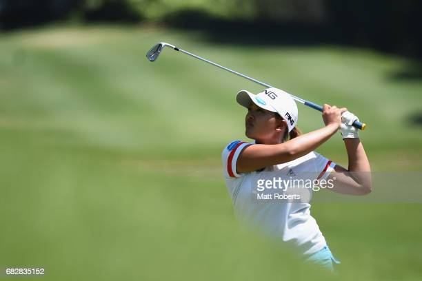 Ai Suzuki of Japan hits her second shot on the 9th hole during the final round of the HokennoMadoguchi Ladies at the Fukuoka Country Club Wajiro...