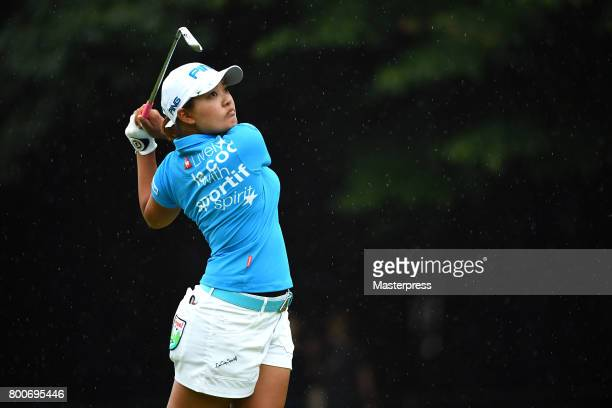 Ai Suzuki of Japan hits her tee shot on the 14th hole during the final round of the Earth Mondamin Cup at the Camellia Hills Country Club on June 25...