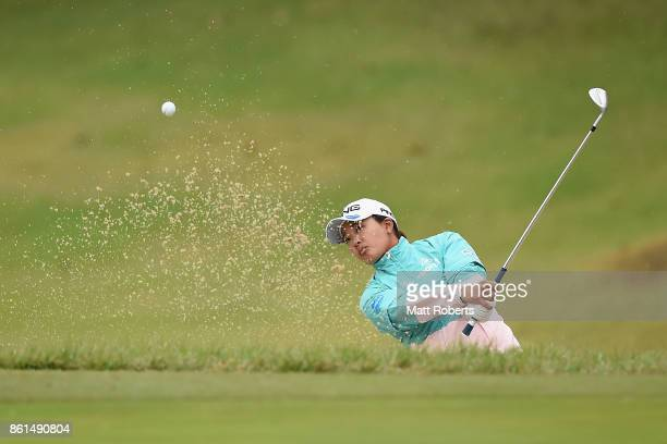 Ai Suzuki of Japan hits out of the 4th green bunker during the final round of the Fujitsu Ladies 2017 at the Tokyu Seven Hundred Club on October 15...