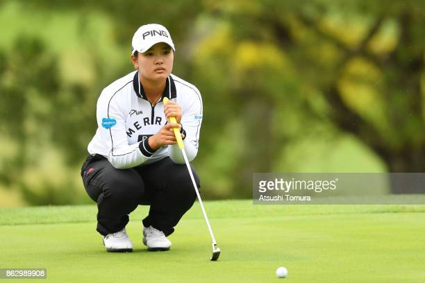 Ai Suzuki of Japan lines up her putt on the 17th hole during the first round of the Nobuta Group Masters GC Ladies at the Masters Golf Club on...