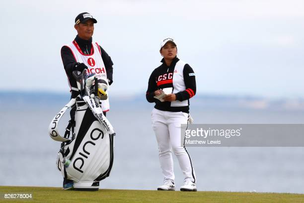 Ai Suzuki of Japan looks on with her caddie during the second round of the Ricoh Women's British Open at Kingsbarns Golf Links on August 4 2017 in...