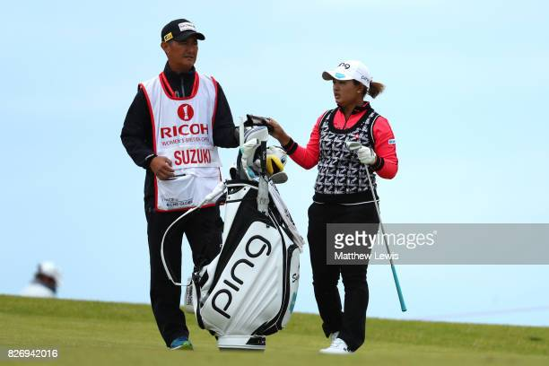 Ai Suzuki of Japan picks a club during the final round of the Ricoh Women's British Open at Kingsbarns Golf Links on August 6 2017 in Kingsbarns...