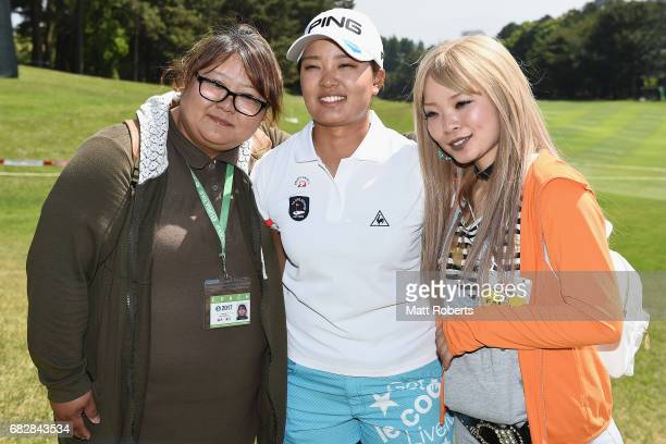 Ai Suzuki of Japan poses with coach Mie Suzuki during the final round of the HokennoMadoguchi Ladies at the Fukuoka Country Club Wajiro Course on May...