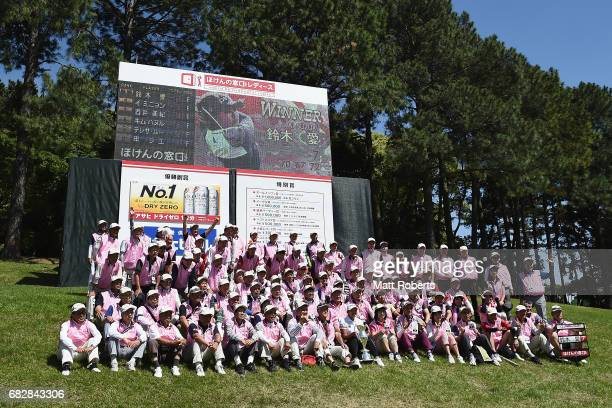 Ai Suzuki of Japan poses with volunteers after winning the HokennoMadoguchi Ladies at the Fukuoka Country Club Wajiro Course on May 14 2017 in...
