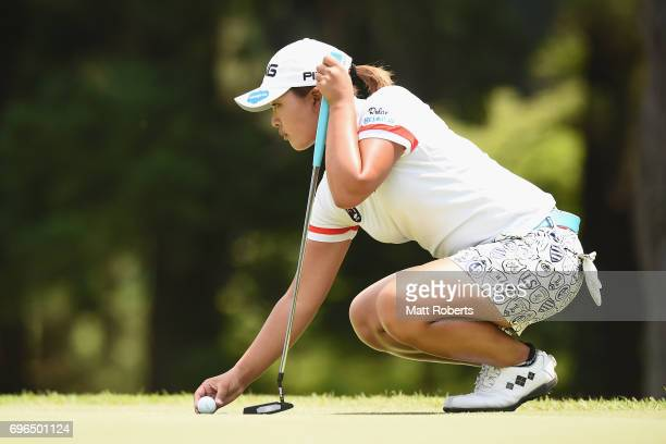Ai Suzuki of Japan prepares to putt on the first green during the first round of the Nichirei Ladies at the Sodegaura Country Club Shinsode Course on...