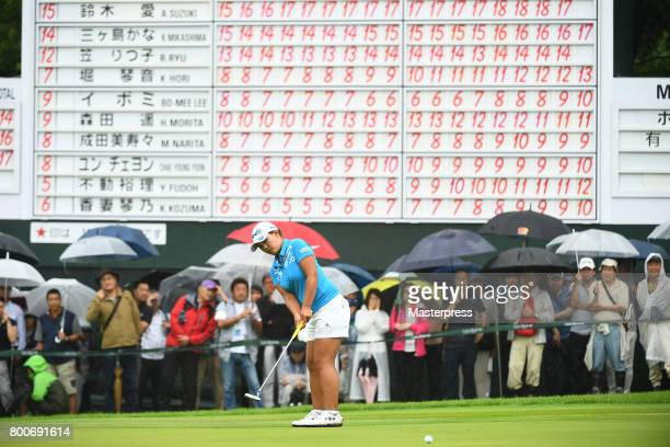 Ai Suzuki of Japan putts for the birdie on the 18th green during the final round of the Earth Mondamin Cup at the Camellia Hills Country Club on June...
