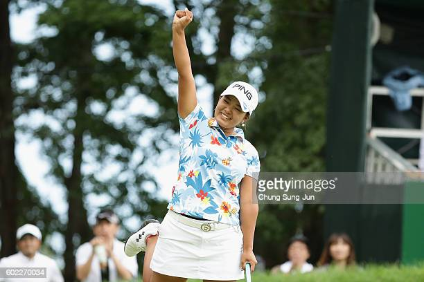 Ai Suzuki of Japan reacts after a birdie putt on the 18th green during the final round of the 49th LPGA Championship Konica Minolta Cup 2016 at the...