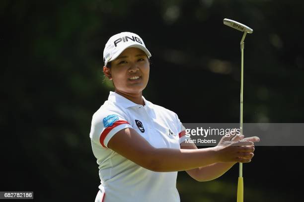 Ai Suzuki of Japan reacts after her putt on the 6th green during the final round of the HokennoMadoguchi Ladies at the Fukuoka Country Club Wajiro...