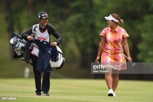 Ai Suzuki of Japan shares a laugh with her caddie during the final round of the Nichirei Ladies at the on June 18 2017 in Chiba Japan