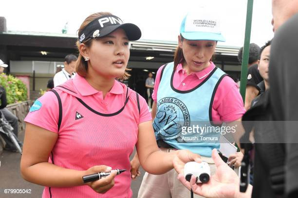 Ai Suzuki of Japan signs autographs for fans during the final round of the World Ladies Championship Salonpas Cup at the Ibaraki Golf Club on May 7...