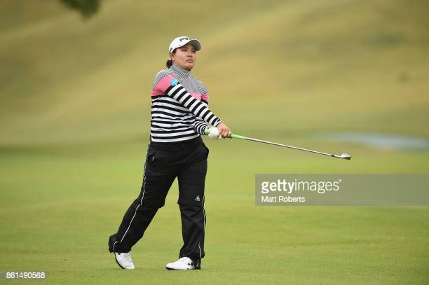 Ai Suzuki of Japan watches her second shot on the 11th hole during the final round of the Fujitsu Ladies 2017 at the Tokyu Seven Hundred Club on...