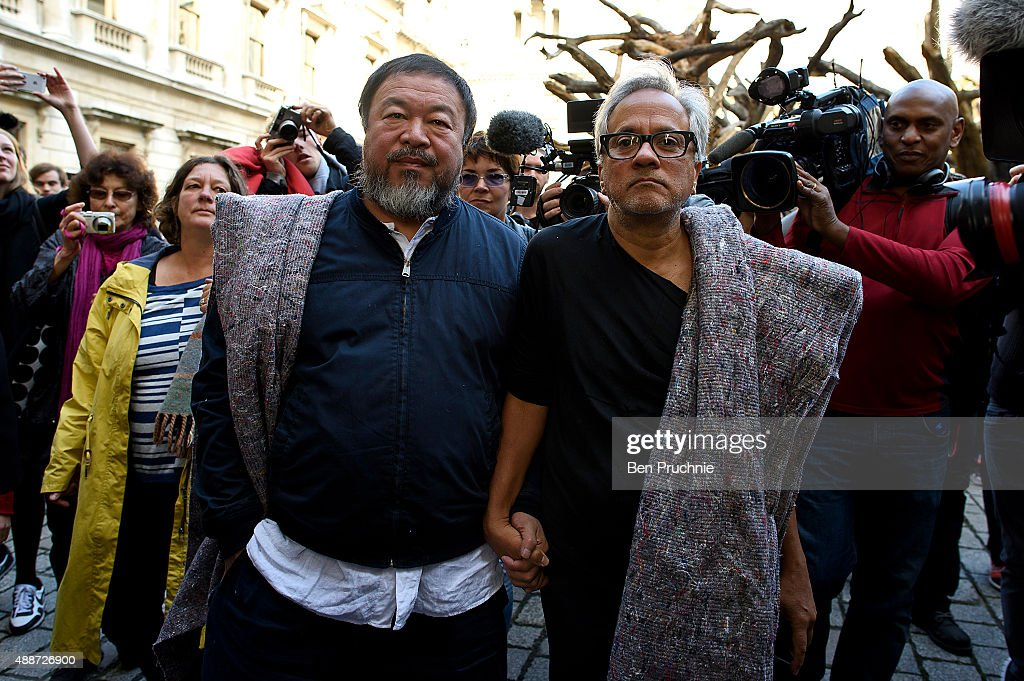 <a gi-track='captionPersonalityLinkClicked' href=/galleries/search?phrase=Ai+Weiwei&family=editorial&specificpeople=4331218 ng-click='$event.stopPropagation()'>Ai Weiwei</a> (L) and <a gi-track='captionPersonalityLinkClicked' href=/galleries/search?phrase=Anish+Kapoor&family=editorial&specificpeople=3965986 ng-click='$event.stopPropagation()'>Anish Kapoor</a> depart the Royal Academy as they walk through the city as part of a march in solidarity with migrants currently crossing Europe on September 17, 2015 in London, England. Each artist carried a single blanket symbolizing the needs that face migrants coming to Europe.