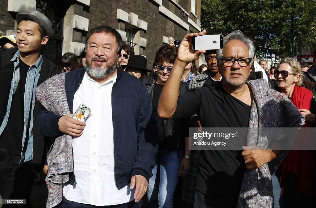 Ai Weiwei (L) and Anish Kapoor (R) depart the Royal Academy as they walk through the city as part of a march in solidarity with migrants currently crossing Europe on September 17, 2015 in London, England. Each artist carried a single blanket symbolizing the needs that face migrants coming to Europe.