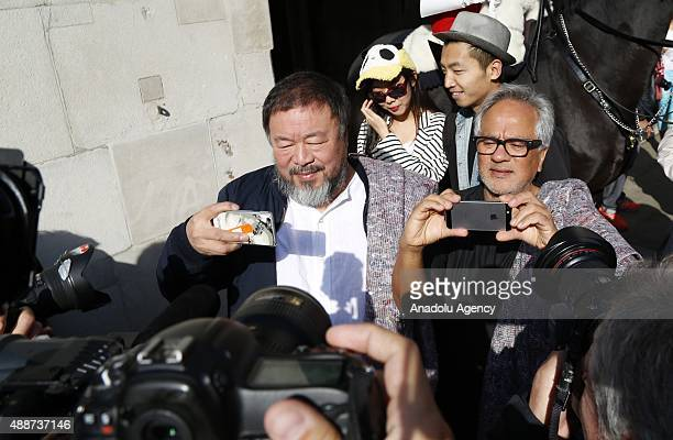 Ai Weiwei and Anish Kapoor depart the Royal Academy as they walk through the city as part of a march in solidarity with migrants currently crossing...