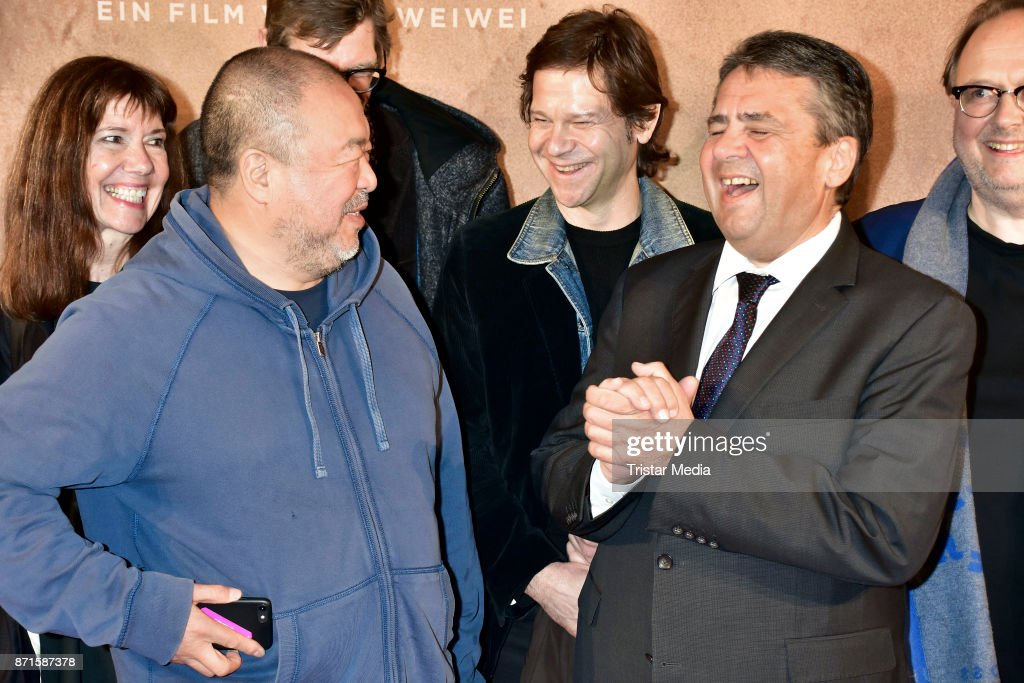 Ai Weiwei and German politician Sigmar Gabriel during the 'Human Flow' premiere at Kino International on November 7, 2017 in Berlin, Germany.