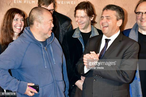 Ai Weiwei and German politician Sigmar Gabriel during the 'Human Flow' premiere at Kino International on November 7 2017 in Berlin Germany