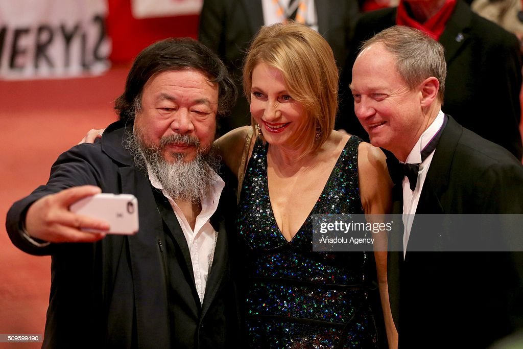 Ai Weiwei (left) and John B. Emerson (R), United States Ambassador to Germany, pose for a selfie as they attend the 'Hail, Caesar!' premiere during the 66th Berlinale International Film Festival Berlin at Berlinale Palace in Berlin, Germany on February 11, 2016.