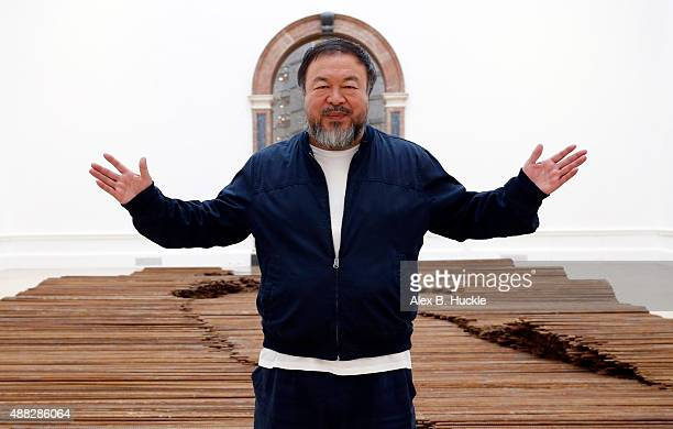 Ai Weiwei stands with his sculpture 'Straight' as he previews works from His landmark art exhibition on September 15 2015 in London England The Royal...