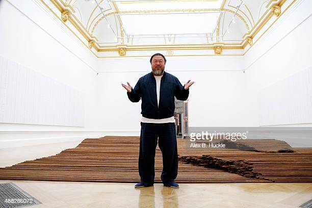 Ai Weiwei stands with his sculpture 'Straight' as he previews works from His landmark art exhibition at the Royal Academy of Arts on September 15...