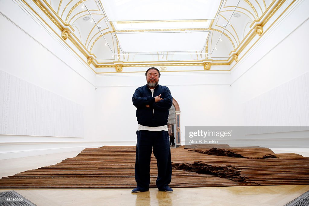 Ai Weiwei stands with his sculpture 'Straight' as he previews works from His landmark art exhibition at the Royal Academy of Arts on September 15, 2015 in London, England. The Royal Academy of Art is showing the work of one of China's leading contemporary artists until mid-December. Ai Weiwei's activism in China saw him detained without charge in 2011 for 81 days.