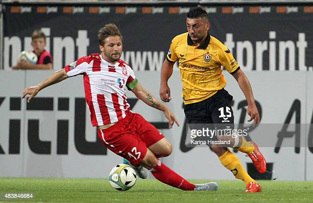 Aias Aosman of Dresden challenges Sebastian Tyrala of Erfurt during the Third League match between SG Dynamo Dresden and FC RotWeiss Erfurt at...