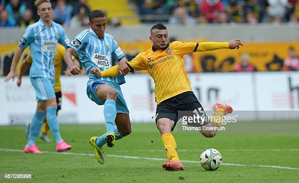 Aias Aosman of Dresden is challenged by Raphael Jamil Dem of Chemnitz during the Third League match between SG Dynamo Dresden and Chemnitzer FC at...
