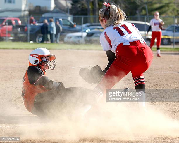 Aibhlin Oconnor of Biddeford slides safely ahead of the tag from Miranda Gleason of South Portland in the fifth inning at Biddeford's Rotary Park