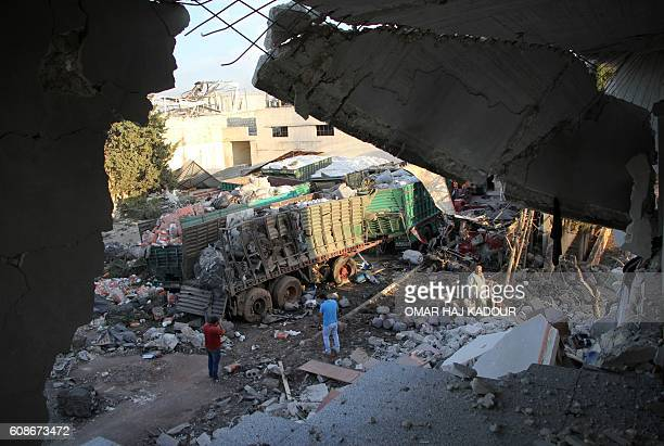 TOPSHOT Aid is seen strewn across the floor in the town of Orum alKubra on the western outskirts of the northern Syrian city of Aleppo on September...