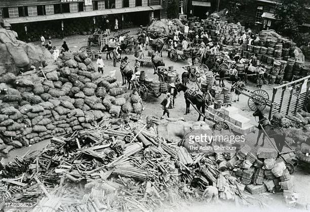 Aid supply are collected at Ichigaya Elementary School after the Great Kanto Earthquake victims and debris float in Sumida River in September 1923 in...