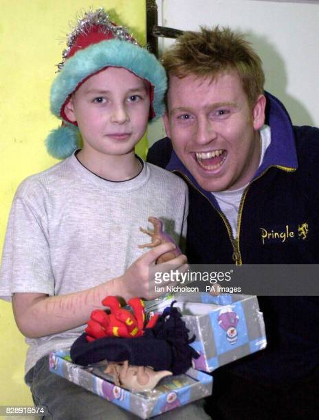 Aid volunteer Steve Robinson an officer with the Merseyside Police meets Pasha during a visit to an orphanage in Tula south of Moscow as part of...