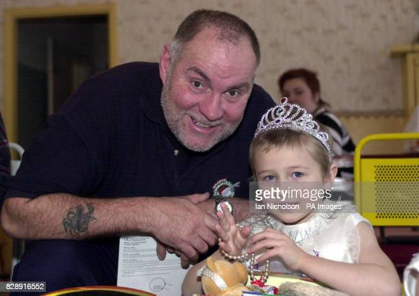 Aid worker Arthur White from Essex meets Natasha during a visit to an orphanage in Tula south of Moscow as part of Operation Christmas Child The...